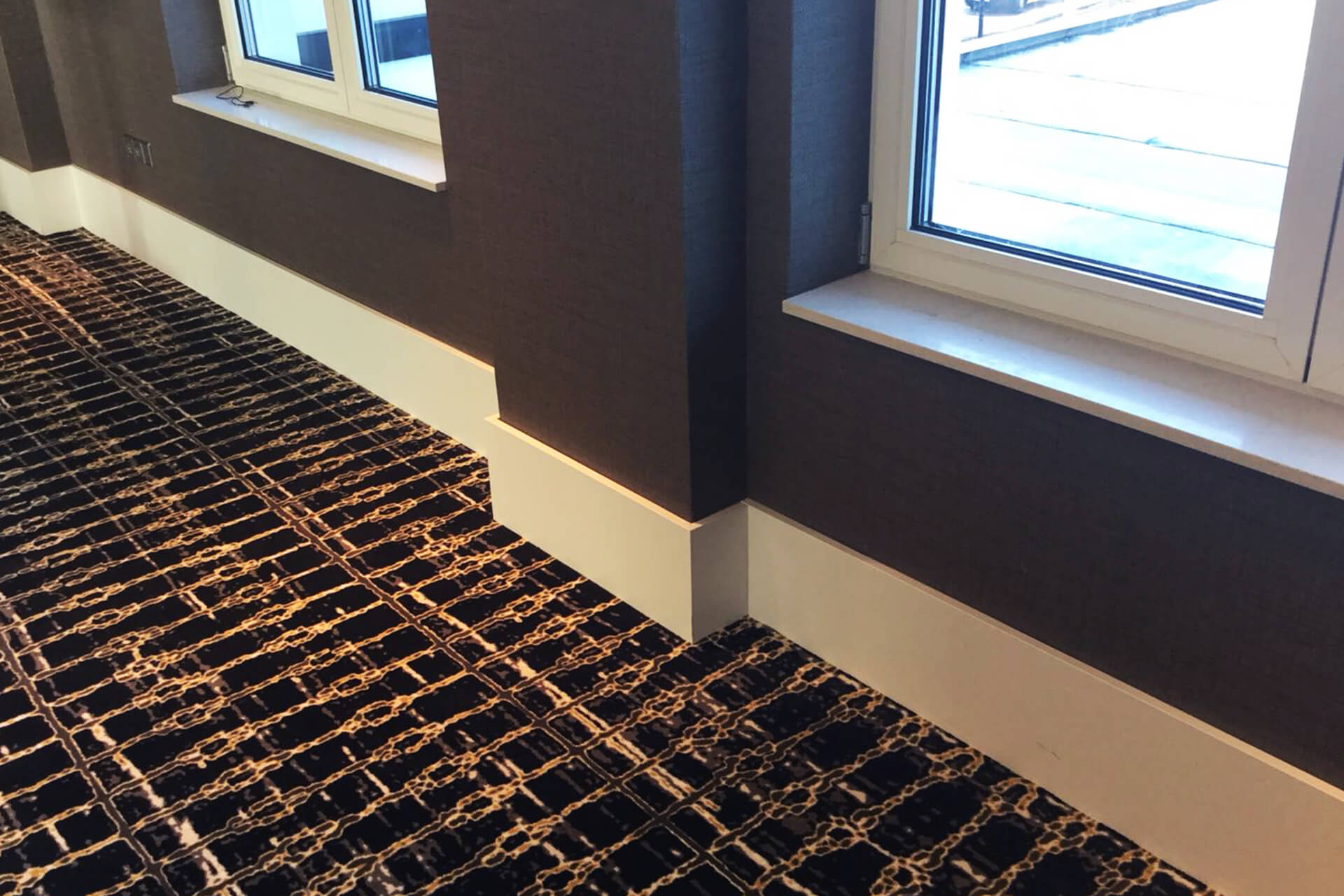Skirting boards in a hotel sheathed with plastic